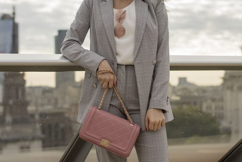 city look with checked suit