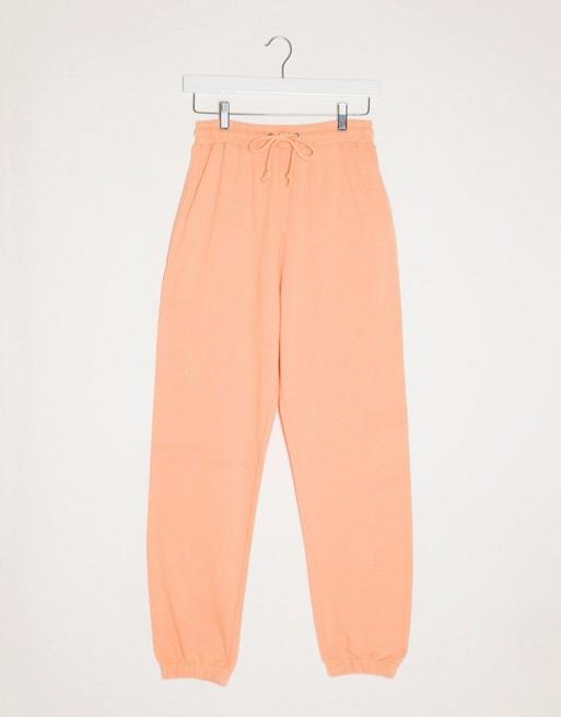 orange joggers missguided