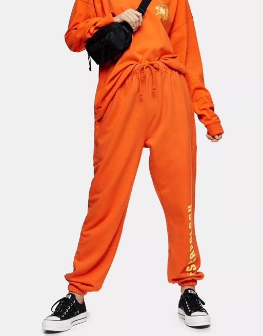orange joggers