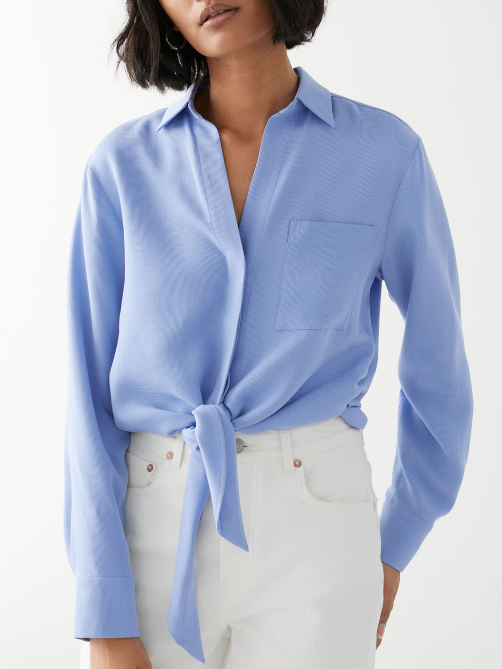 blue shirt with knot