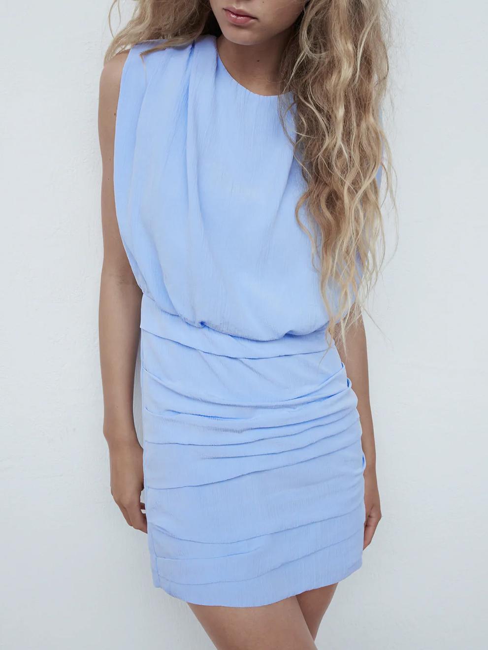 blue draped dress