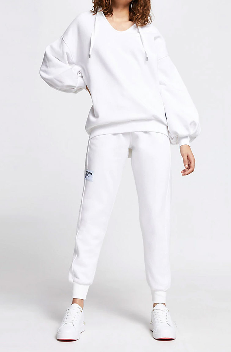 white tracksuit woman