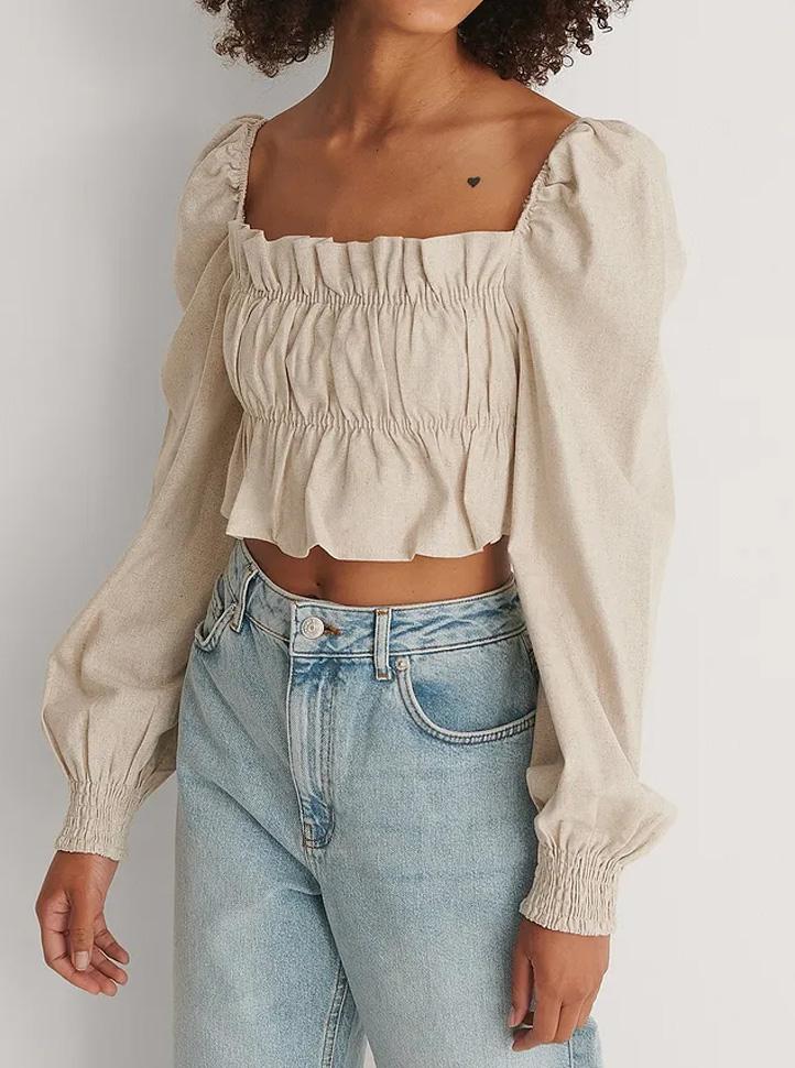 beige ruffle blouse